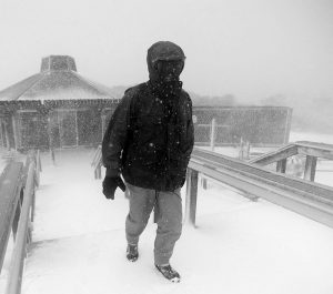 BRIAN LIBBY of Eastham, Mass., walks back from looking at Nauset Light Beach where the steps were washed away during the storm Monday, Feb. 8, 2016. A wind-driven winter storm brought blizzard conditions to Cape Cod and threatened to drop up to 18 inches of snow on southeastern Massachusetts on Monday.