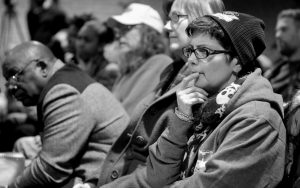 STEPHANIE VONDRASEK, 54, listens to the public comments during the Ferguson city council meeting in Ferguson, Missouri, on Tuesday, where the consent decree with the United States Department of Justice was being talked about.