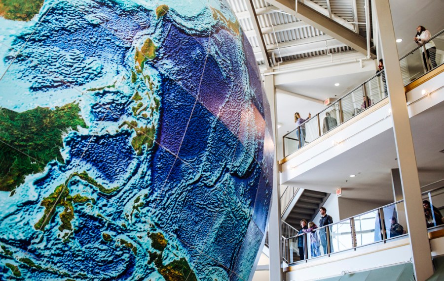 Fans mourn closing of DeLorme s map store   Portland Press Herald Visitors take selfies and look at the giant globe on display in the lobby  outside the DeLorme map store on its closing day in Yarmouth