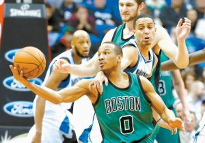 BOSTON'S Avery Bradley, left, keeps control of the ball as he is grabbed by Minnesota Timberwolves' Kevin Martin during the second half of an NBA basketball game Monday in Minneapolis. The Timberwolves won, 124-122.