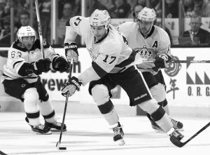 L0S ANGELES FORWARD Milan Lucic (17) skates past Boston Bruins' Brad Marchand during the third period of the Los Angeles Kings 9-2 win over the Boston Bruins in an NHL hockey game in Boston on Tuesday.