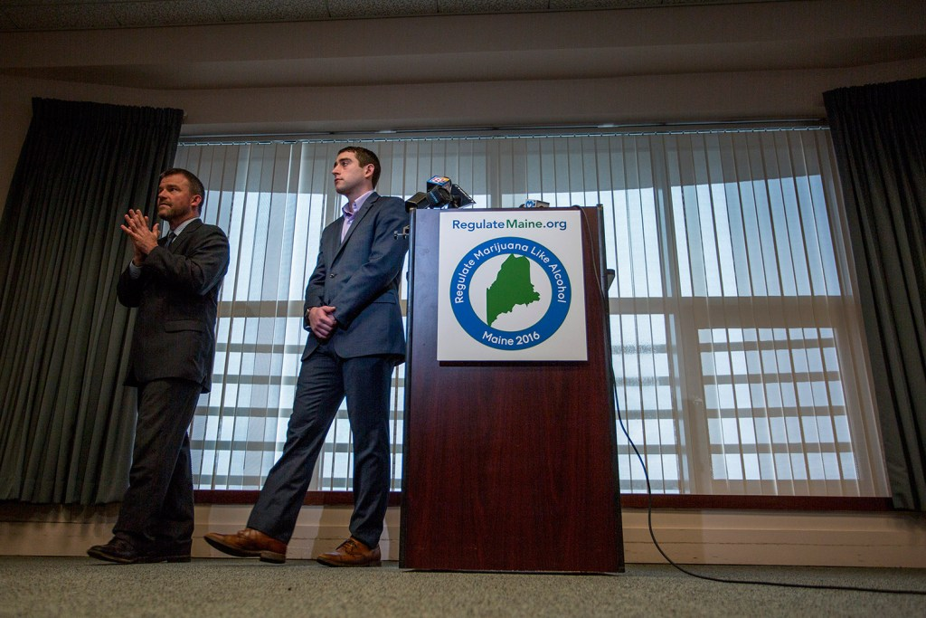 Attorney Scott Anderson, left, and David Boyer, campaign manager for the Campaign to Regulate Marijuana Like Alcohol, step away from a podium Thursday at Verrill Dana in Portland after announcing their lawsuit to appeal the Maine secretary of state's decision to disqualify the question of  legalizing marijuana from the November ballot.