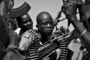 SOUTH SUDAN GOVERNMENT SOLDIERS are pictured in this 2015 file photo in the town of Koch, Unity state, South Sudan. A U.N. report describing sweeping crimes like children and the disabled being burned alive and fighters being allowed to rape women as payment shows South Sudan is facing