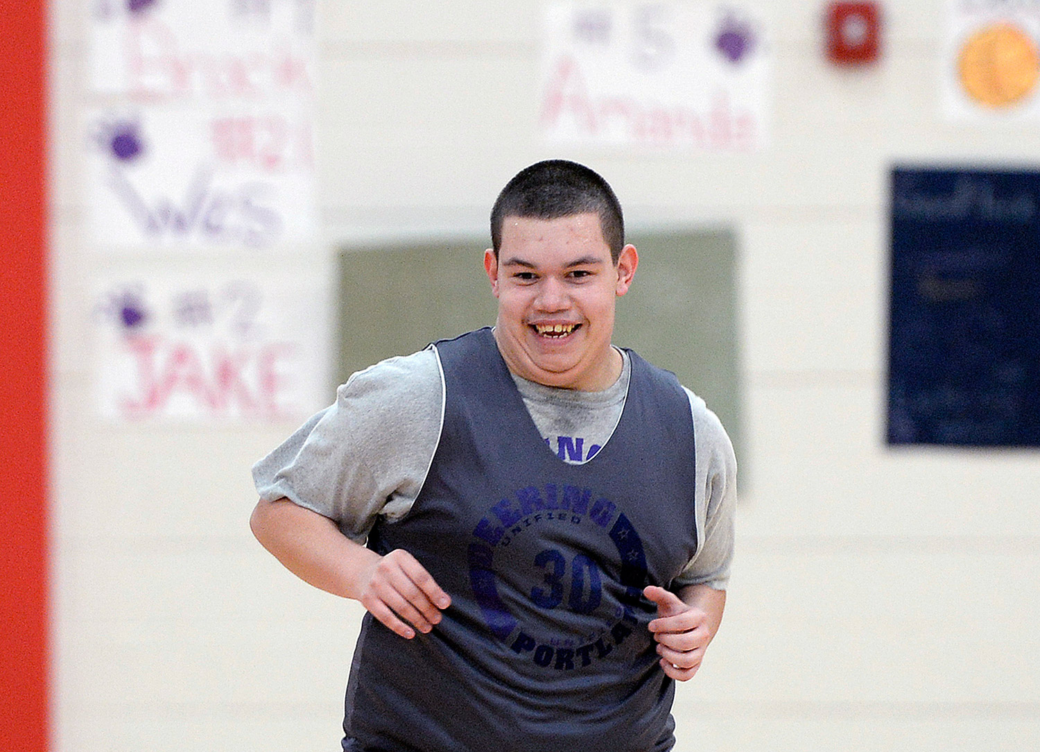 Portland/Deering's Christian Perez is all smiles after scoring a basket in action against Lisbon.