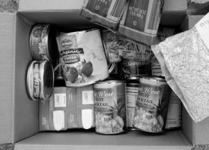 THE CONTENTS of a specially prepared box of food at a food bank distribution in Petaluma, California, in this 2014 photo as par t of a research project with Feeding America to tr y to improve the health of diabetics in food-insecure families. California plans to delay state-required warnings on metal cans lined with the chemical BPA, arguing too-specific warnings could scare stores and shoppers in poor neighborhoods away from some of the only fruits and vegetables available — canned ones, officials said Thursday.