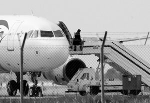 A PASSENGER leaves a hijacked EgyptAir aircraft after landing at Larnaca Airport in Cyprus Tuesday, March 29, 2016. An Egyptian man hijacked the EgyptAir plane Tuesday and forced it to land in Cyprus, where all but several foreign passengers and the crew were eventually allowed to get off, Egyptian and Cypriot officials said.