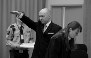 ANDERS BEHRING BREIVIK gestures as he enters a courtroom in Skien, Norway, today. Breivik, the right-wing extremist who killed 77 people in bomb and gun attacks in 2011 arrived in court today for his human rights case against the Norwegian government.