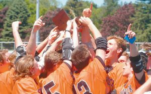 THE BRUNSWICK HIGH SCHOOL boys lacrosse team celebrates after downing South Portland last season in the State Class A championship in Portland. The Dragons held their first practice of the spring season on Monday.