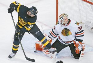 CHICAGO BLACKHAWKS goalie Scott Darling (33) makes a save as Boston Bruins left wing Matt Beleskey (39) tries to backhand the rebound during the third period of an NHL hockey game in Boston on Thursday. See the story on B1.