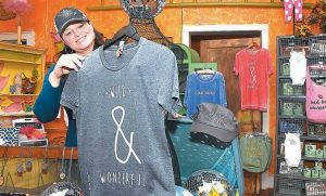 WESLEA COLES, co-owner Pretty White Trash in Lewisburg, poses for a photo at the store.