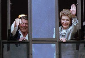In this July 18, 1985, file photo, President Ronald Reagan and his wife, Nancy, wave from windows of his hospital room at the Navy Medical Center in Bethesda, Md. The former first lady has died at 94, The Associated Press confirmed Sunday. (AP Photo/Scott Stewart, File)