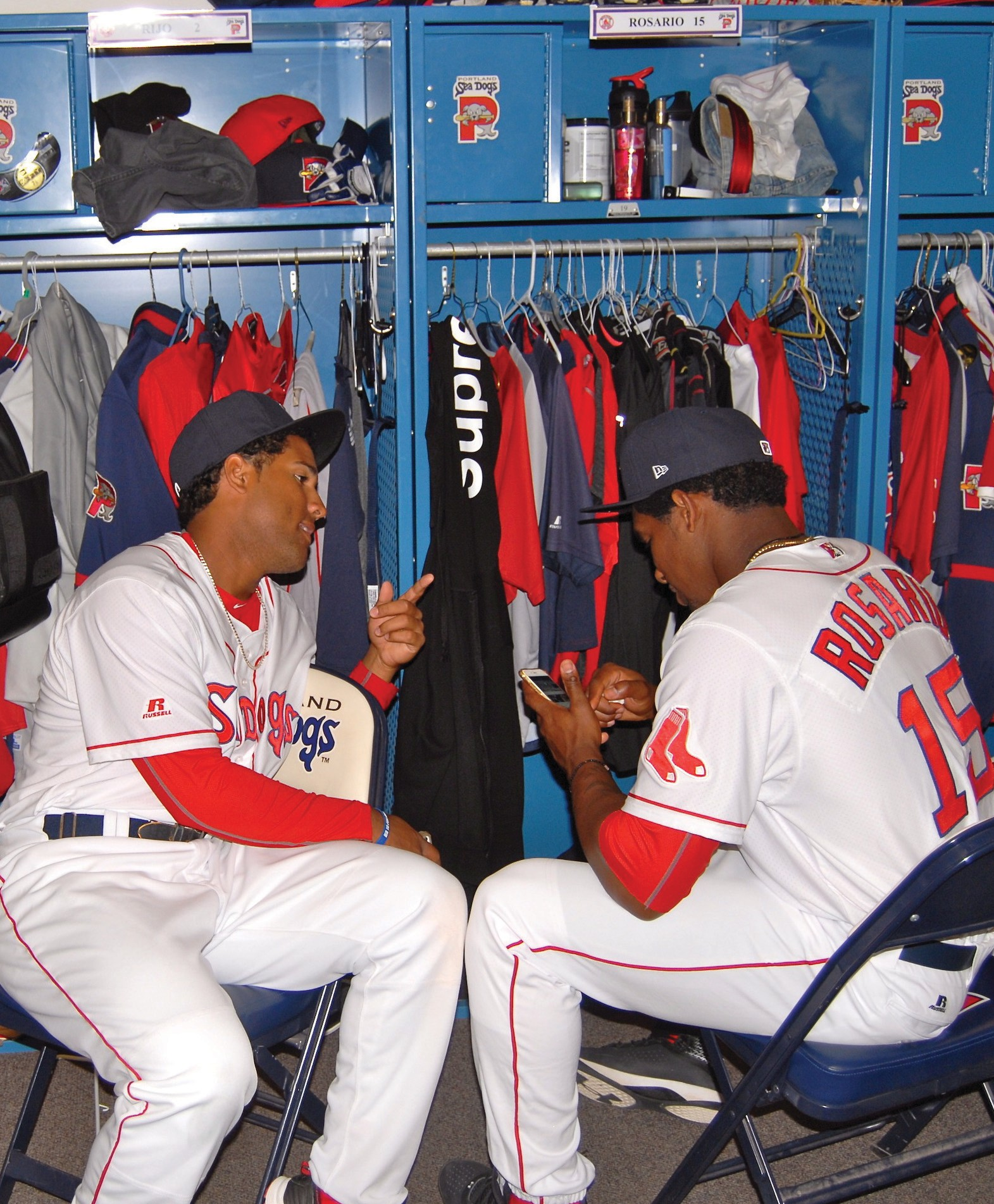Portland Sea Dogs infielder Wendell Rijo (left) talks with outfielder Rainel Rosario during Media Day on Tuesday at Hadlock Field.