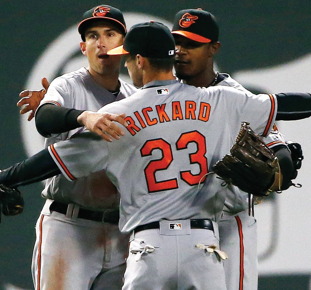 Baltimore Orioles' Joey Rickard (23), Ryan Flaherty, left, and Adam Jones celebrate after defeating the Boston Red Sox 9-5 in Boston on Tuesday.