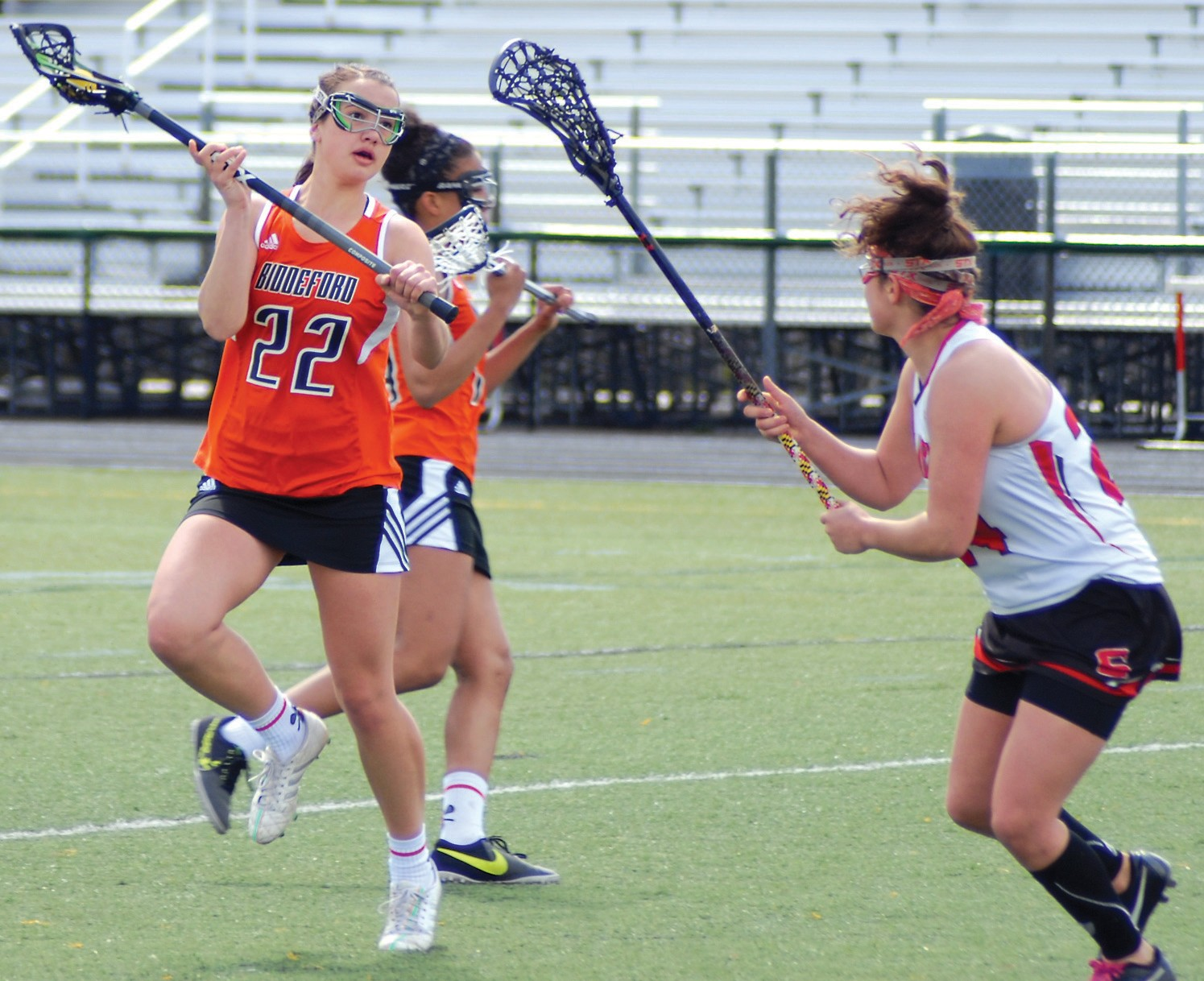 Biddeford's Rebekah Guay looks to make a pass during Tuesday's game at Scarborough.