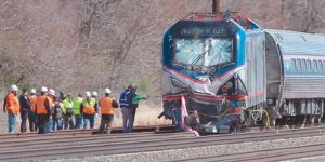 AMTRAK INVESTIGATORS inspect the deadly train crash in Chester, Pa., Sunday. The Amtrak train struck a piece of construction equipment just south of Philadelphia causing a derailment.