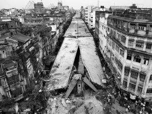 THIS GENERAL VIEW shows a partially collapsed overpass in Kolkata, India, Friday, April 1, 2016. The overpass spanned nearly the width of the street and was designed to ease traffic through the densely crowded Bara Bazaar neighborhood in the capital of the east Indian state of West Bengal. About 300 feet of the overpass fell, while other sections remained standing.
