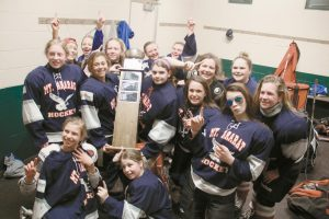 THE MT. ARARAT JUNIOR EAGLES celebrate with the championship trophy in their locker room in Falmouth after downing Oyster River of New Hampshire, 3-2, in the Petterson Division championship of the Southern Maine Middle School Hockey League recently. The first-year club went 7-5 during the regular season, but rolled through the playoffs to record the program's first title.