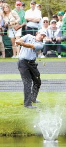FORMER MASTERS CHAMPION Phil Mickelson skips a ball across the traditional water hole on the 16th fairway during a practice round for the Masters golf tournament in Augusta, Ga. For many, the 16th hole is the place to be before the first major of the year.