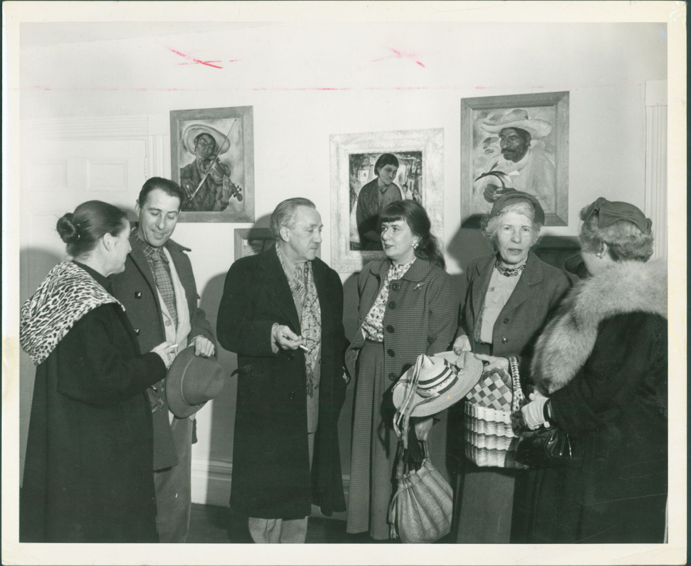 Maine artists, Wiscasset, 1958. Collections of Maine Historical Society. Item #53967 on MaineMemory.net. Maine artists, from left, Ruth Lepper Gardner of West Southport (1905-2011), William Thon of Port Clyde (1906-2000), Gustaf Tenggren (1896-1970) of West Southport, Dahlov Zorach Ipcar of Georgetown (1917- ), Mildred Burrage of Wiscasset (1890-1983), and Margaret Conant of West Southport chat in Wiscasset. All affiliated with the Lincoln County Cultural and Historical Association, the artists were discussing the Red Brick School House, which they hoped to turn into an art gallery that would showcase Maine artists.