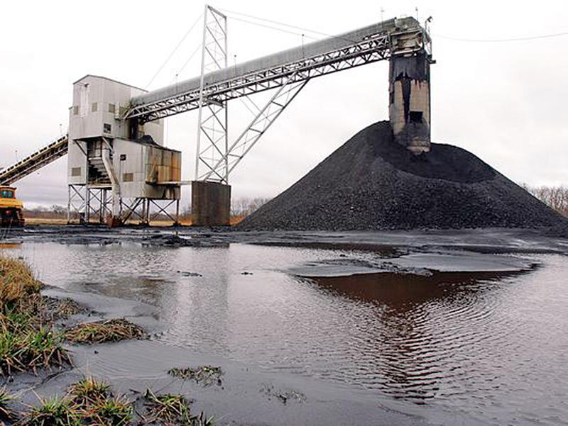 A conveyor belt moves coal mined underground  to the surface at Peabody Energy's Gateway Mine near Coulterville, Ill., in this 2006 file photo. Peabody had about 7,600 employees at the end of last year and has ownership stakes in 26 mines in the U.S. and Australia. The Associated Press