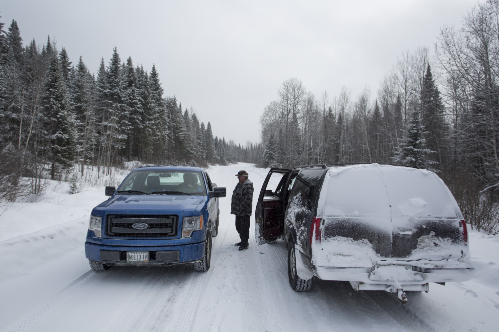 <b>THE NORTH WOODS:</b> Carter McBreairty stops to talk with a friend while touring forestland north of Allagash owned by Irving Woodlands.