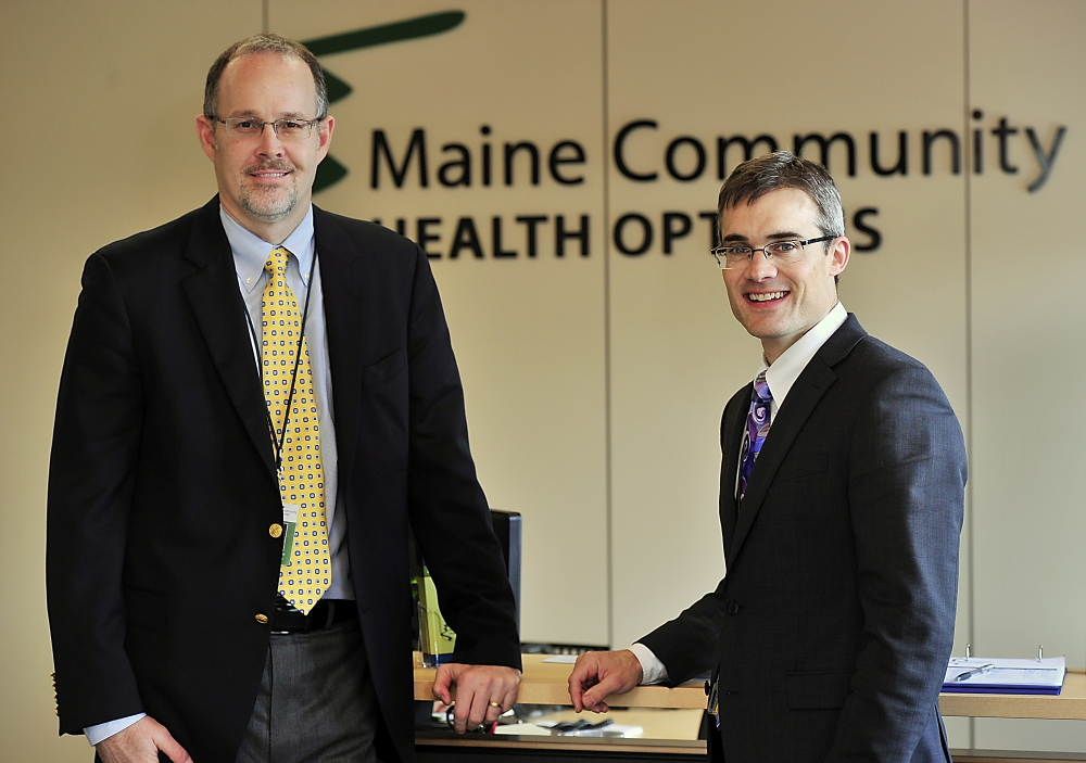 Chief Operating Officer Robert Hillman, left, and CEO Kevin Lewis are founders of Maine Community Health Options.