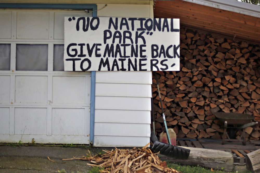 A sign in opposition to a proposed national park is seen on a home in Millinocket.