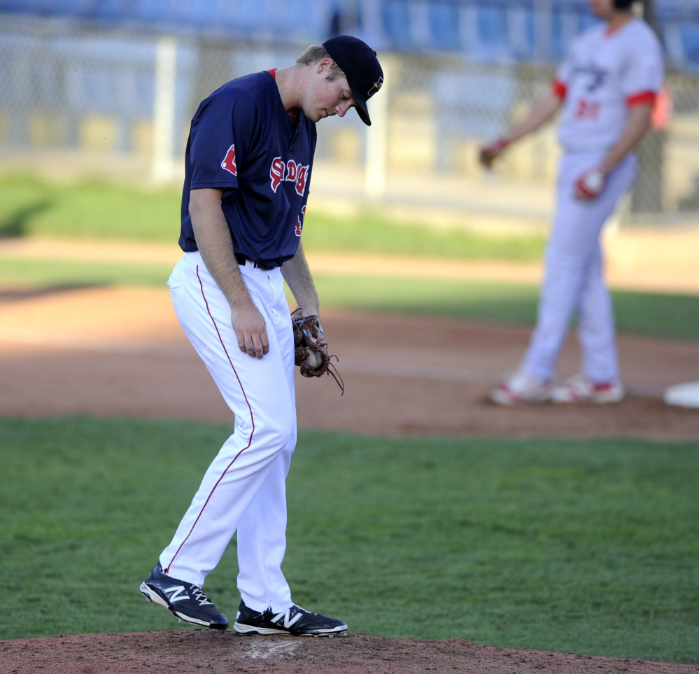 Starting pitcher Ty Buttrey of the Portland Sea Dogs reacts Tuesday night after walking in a run during a three-run fifth inning, part of a 6-4 loss to Reading at Hadlock Field.