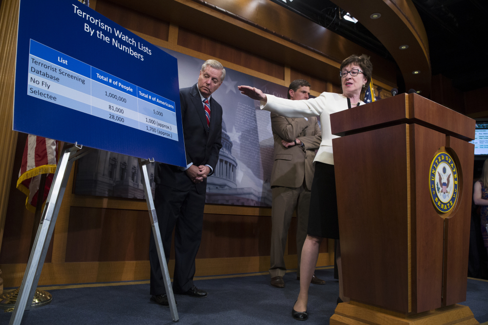 "Sen. Susan Collins, R-Maine, accompanied by Sen. Lindsey Graham, R-S.C., left, and Sen. Martin Heinrich, D-N.M., behind Collins, uses a chart Tuesday to indicate the number of people who would be affected by her proposed ""no fly, no buy"" restriction on firearm sales."