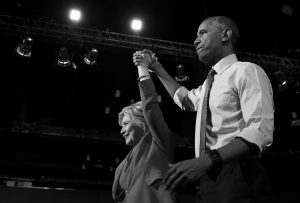 PRESIDENT BARACK OBAMA and Democratic presidential candidate Hillary Clinton wave following a campaign event at the Charlotte Convention Center in Charlotte, North Carolina, Tuesday. Obama is spending the afternoon campaigning for Clinton.