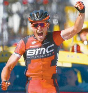 BELGIUM'S Greg van Avermaet celebrates as he crosses the finish line to win the fifth stage and take the overall leader's yellow jersey of the Tour de France cycling race over 134.2 miles, with the start in Limoges and finish in Le Lioran, France on Wednesday.