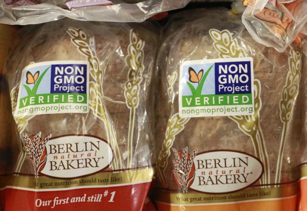 Products labeled as containing no Genetically Modified Organisms, GMOs, for sale at a store. A bill passed by Congress on Thursday would essentially pre-empt Maine's tougher labeling law.