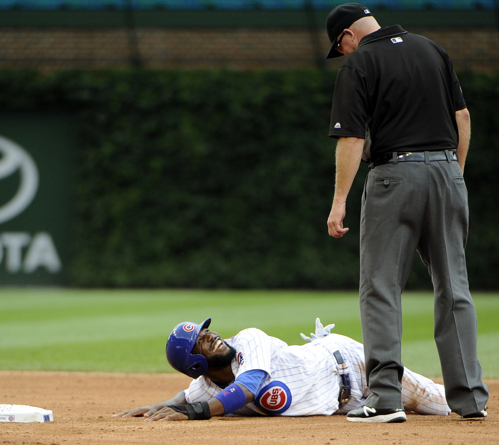 Dexter Fowler of the Chicago Cubs looks up at umpire Ron Kulpa after being called out trying to steal second Saturday during an 8-4 loss to St. Louis.