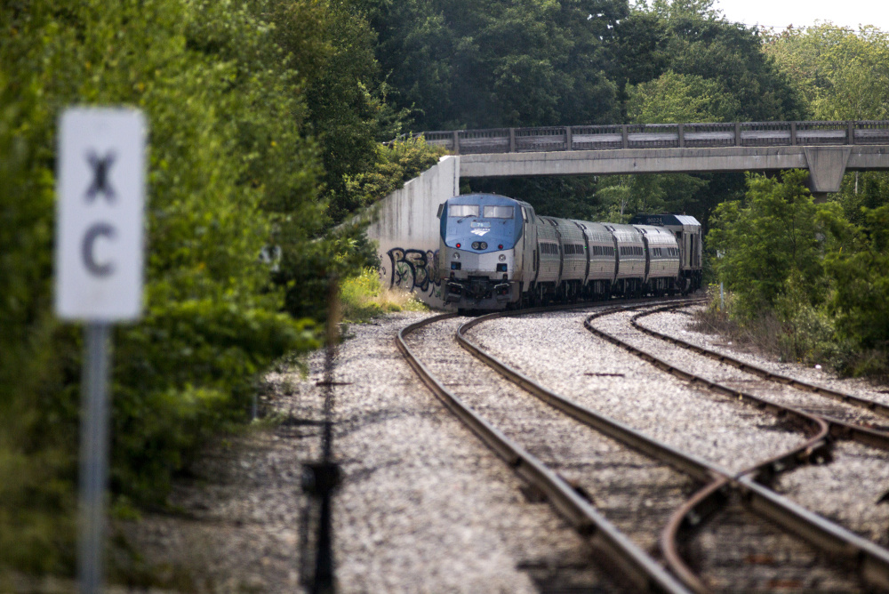 The northbound Amtrak Downeaster heads toward it's stop in Brunswick on Friday. Amtrak secured funding to install a rail siding that will allow the agency to run five daily round trips between Brunswick and Boston. The Downeaster now only runs two-round trips between Brunswick and Boston, but will add a third when it completes a layover shed in September.