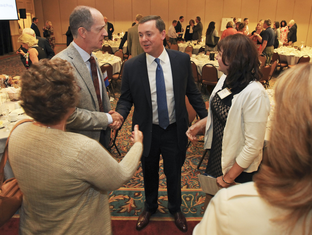 Chris Cox, executive director of the NRA Institute for Legislative Action, greets Robert Tracy, left, of South Portland, and others after speaking at the 2016 Freedom & Opportunity Luncheon put on by the Maine Heritage Policy Center at the Holiday Inn By the Bay in Portland on Wednesday.