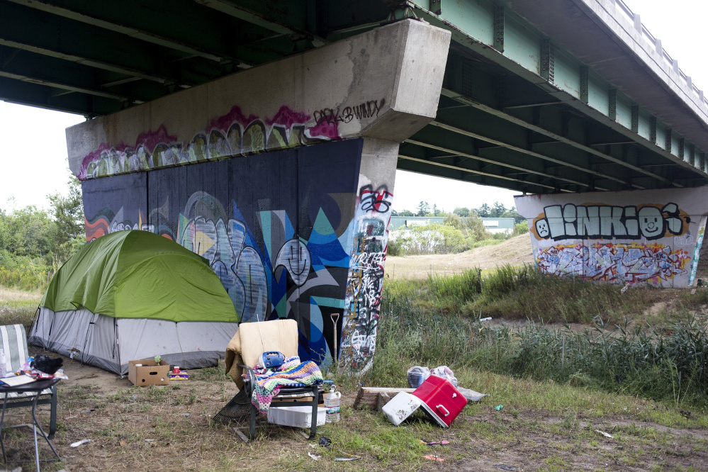Most camp occupants appeared to be complying with the police order to leave, but some residents living under this Maine Turnpike overpass have said they don't plan to go anywhere.