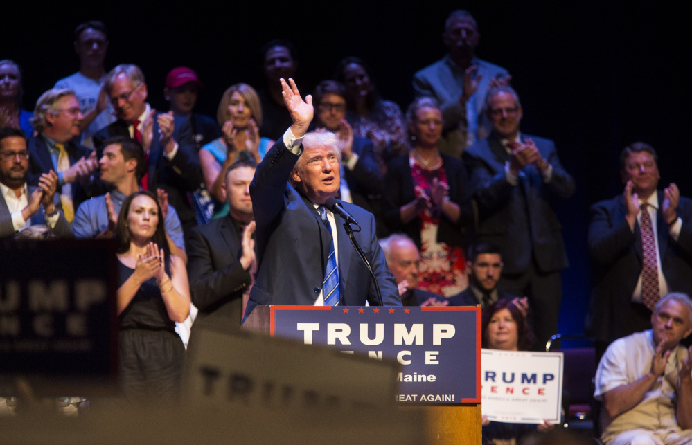 "Donald Trump acknowledges applause Thursday during his speech at Merrill Auditorium. On immigration, he said the refugees admitted by the U.S. are ""coming from among the most dangerous territories and countries anywhere in the world. This is a practice that has to stop."""