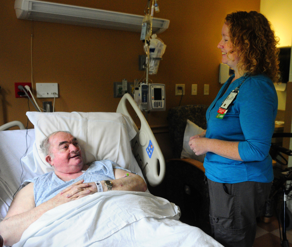 Veteran Curt Ramsdell of Baileyville chats with nurse Angela Boynton on Thursday in Building 200, the main hospital at the VA Maine Healthcare Systems-Togus campus outside Augusta.
