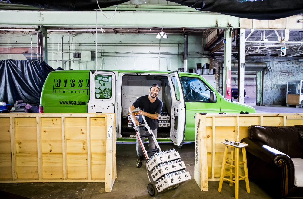 "Josh Schlesinger, owner of Sleek Machine Distro, loads his distribution van last month with Bissell Brothers beer for delivery to Ohno Cafe and the Bier Cellar on Forest Avenue in Portland. His one client, which opened in 2013, is one of the hottest brewers in Maine. ""On a marketplace end, it's my baby. I am deeply devoted to this beer,"" he said."