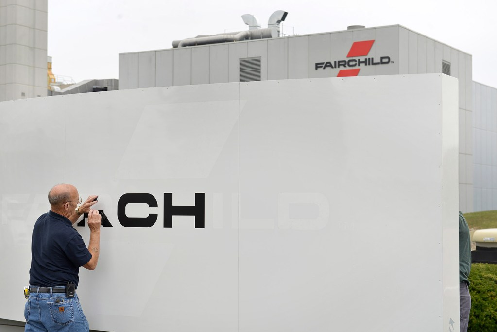 Workers began taking down Fairchild Semiconductor signs Monday with the completion of the company's sale to ON Semiconductor. Gov. Paul LePage said Tuesday that the sale will likely cost Maine hundreds of jobs. John Ewing/Staff Photographer