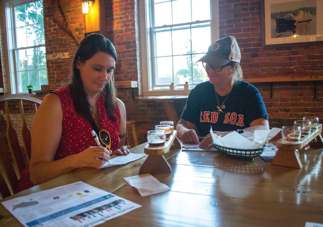 """Heidi Drew, 40, of Biddeford, left, and Missy Esty, 48, of Westbrook, right, fill out their ballots for a """"beer election"""" sponsored by the Committee for Ranked Choice Voting at Dirigo Brewing Co. Thursday."""