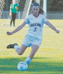 OLIVIA GREUEL strikes a ball for Freeport during the Falcons' 2-0 setback to Kennebunk in Freeport on Thursday.