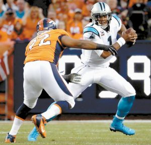 CAROLINA PANTHERS QUARTERBACK Cam Newton (1) is pressured by Denver Broncos nose tackle Sylvester Williams during the first half of an NFL football game on Thursday in Denver.