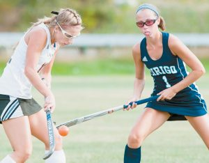 LISBON'S CHASE COLLIER, left, blocks a shot as Dirigo's Ashley Perreault, right, waits to challenge on the play during Wednesday's MVC field hockey game in Lisbon. The Greyhounds won, 1-0, as Collier scored the game's only goal.