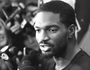 NEW ENGLAND PATRIOTS quarterback Jacoby Brissett speaks with members of the media in the team's locker room following NFL football team practice on Tuesday in Foxborough, Mass.