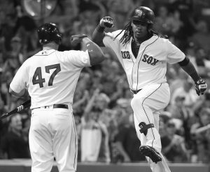 BOSTON RED SOX'S Hanley Ramirez celebrates his solo home run with Travis Shaw (47) during the seventh inning of a baseball game against the New York Yankees in Boston on Sunday.