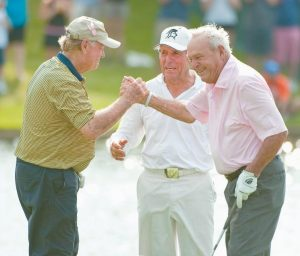 "IN THIS 2012 FILE PHOTO, Jack Nicklaus, left, Gary Player, center, and Arnold Palmer, right, react after Palmer's birdie putt on the 18th green during a Greats of Golf event in The Woodlands, Texas. Palmer, who made golf popular for the masses with his hard-charging style, incomparable charisma and a personal touch that made him known throughout the golf world as ""The King,"" died Sunday in Pittsburgh. He was 87."