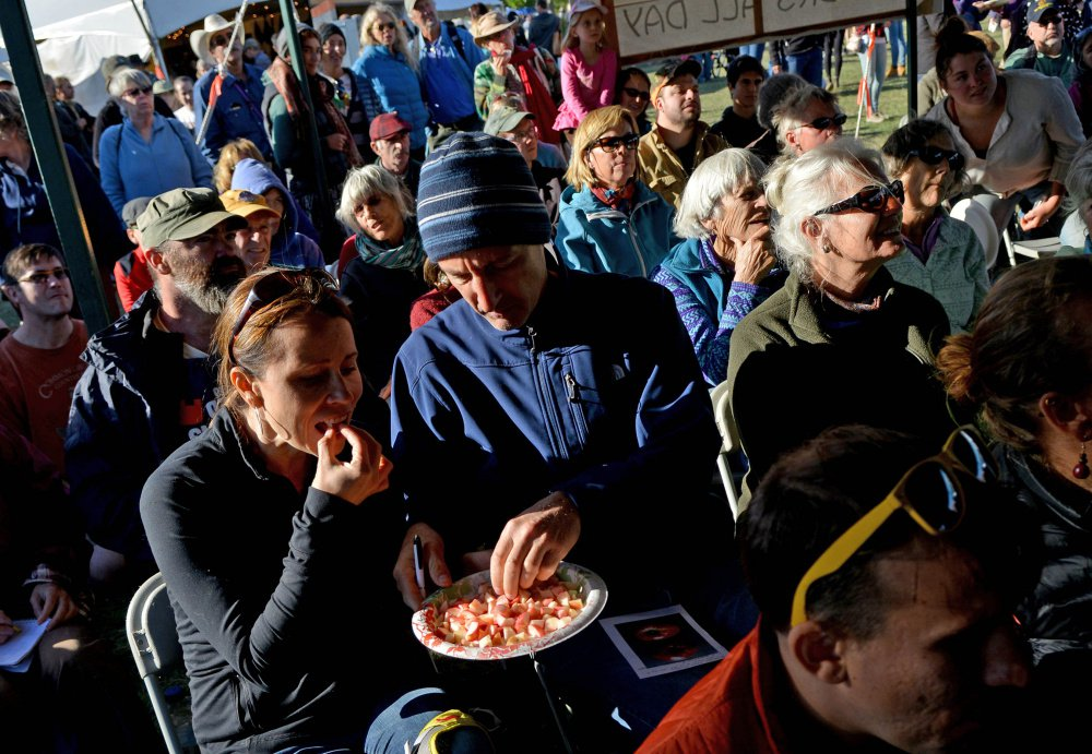 People taste different sample of apples as John Bunker speaks during an apple tasting event at the Common Ground Country Fair in Unity on Saturday. Bunker writes the Fedco Tree catalog and is an expert in apple identification. <em>Michael G. Seamans/Morning Sentinel</em>