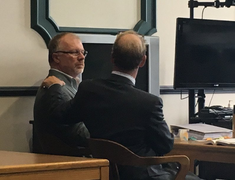 David Brown, left, and his attorney Allan Lobozzo react after Brown was found not guilty by a jury Tuesday in connection with the fatal hayride crash that killed Cassidy Charette in 2014.
