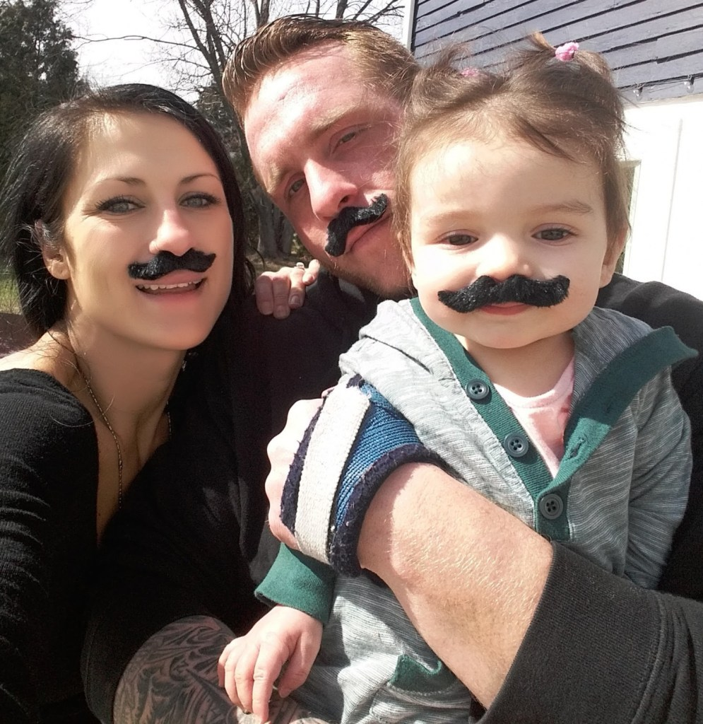 """Devon Higgins, shown with a former girlfriend, Tiffany Voisine, and her daughter, Lily. """"He was doing really well at masonry and was planning to start his own business with a friend,""""  Voisine said."""